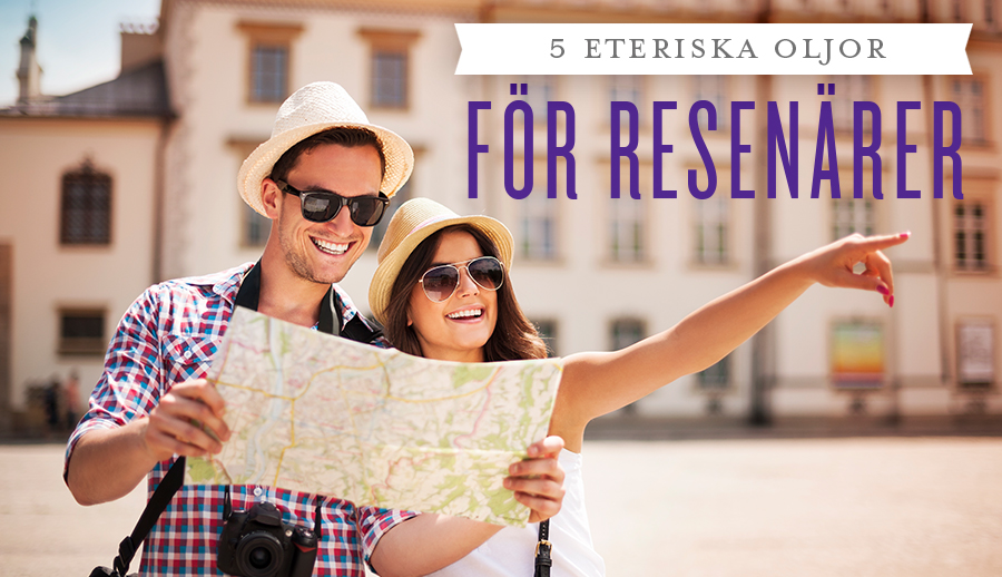 •5 essential oils for travellers with a man and woman smiling and looking at a map