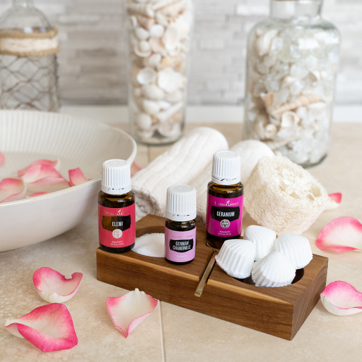 • Bowl of rose water with essential oil bottles