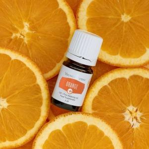 Orange Essential Oil bottle with cut oranges