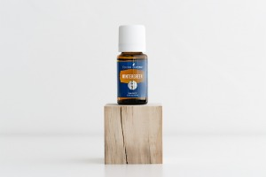 Wintergreen Essential Oil Bottle on Wood Cube