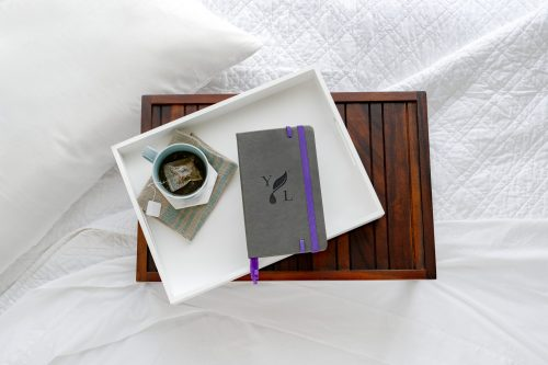 Young Living Journal on a bed