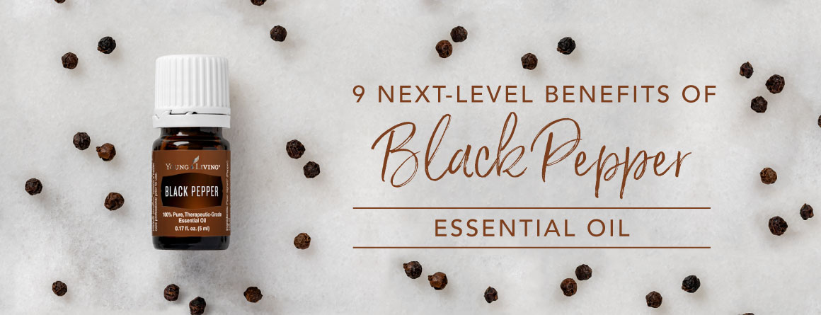 9 next-level benefits of Black Pepper essential oil text by bottle of black pepper essential oil surrounded by scattered peppercorns