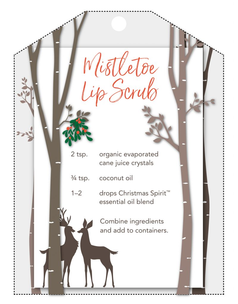 Mistletoe lip scrub printable gift tag showing some deer under mistletoe. Recipe says: Mistletoe lip scrub: 2 tsp organic evaporated cane juice crystals, 3/4 tsp coconut oil, 1 to 2 drops christmas spirit essential oil blend. Combine ingredients and add to containers.