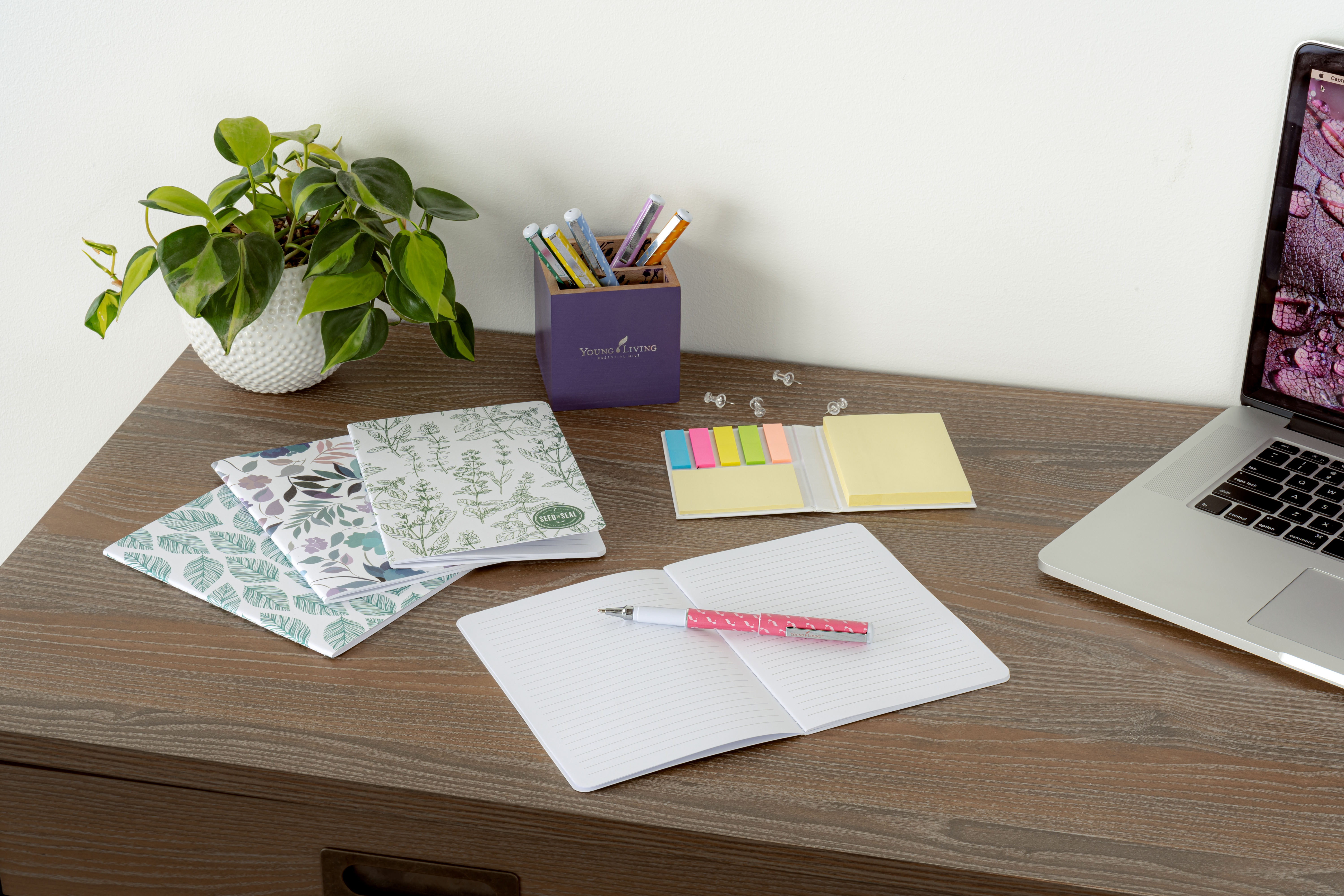 Stocking stuffer ideas: set of notebooks and colorful pens sitting on a desk ready for note taking