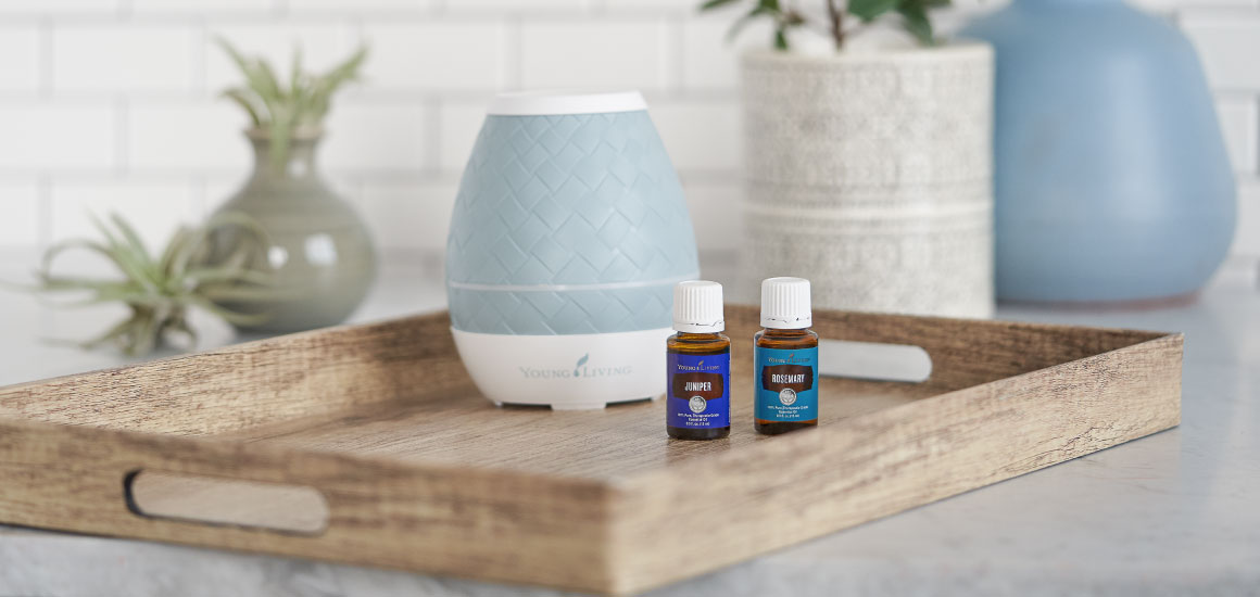 A diffuser and two essential oil bottles in a kitchen