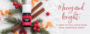 christmas spirit oil laying on top of cinnamon sticks and spruce sprigs showing the many christmas spirit oil uses. Text says: Merry and bright: 11 ways to fill your home with Christmas Spirit