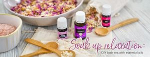 bowls of diy bath tea with essential oils, epsom salt, and flower petals