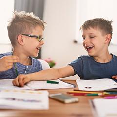 Children doing homework on the table