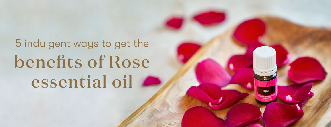 Rose Essential oil surrounded by rose petals