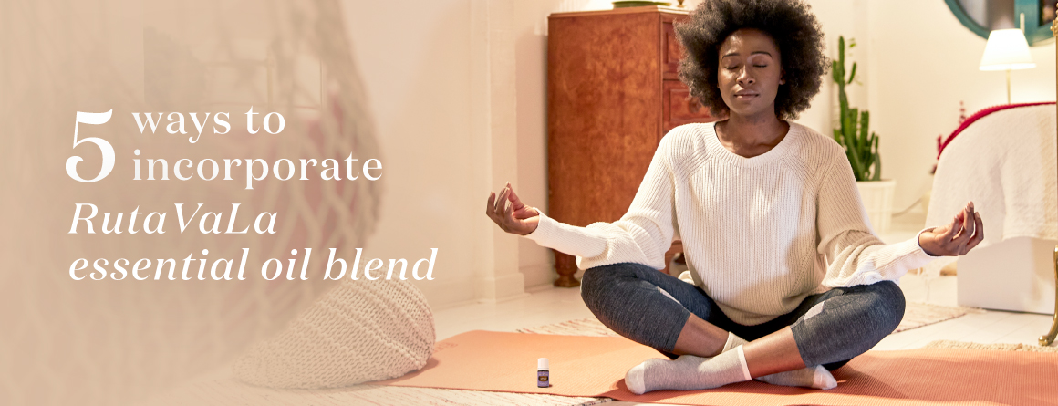 Girl meditating with Young Living RutaVala essential oil blend