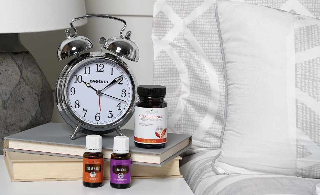 Young Living essential oil products and an alarm clock