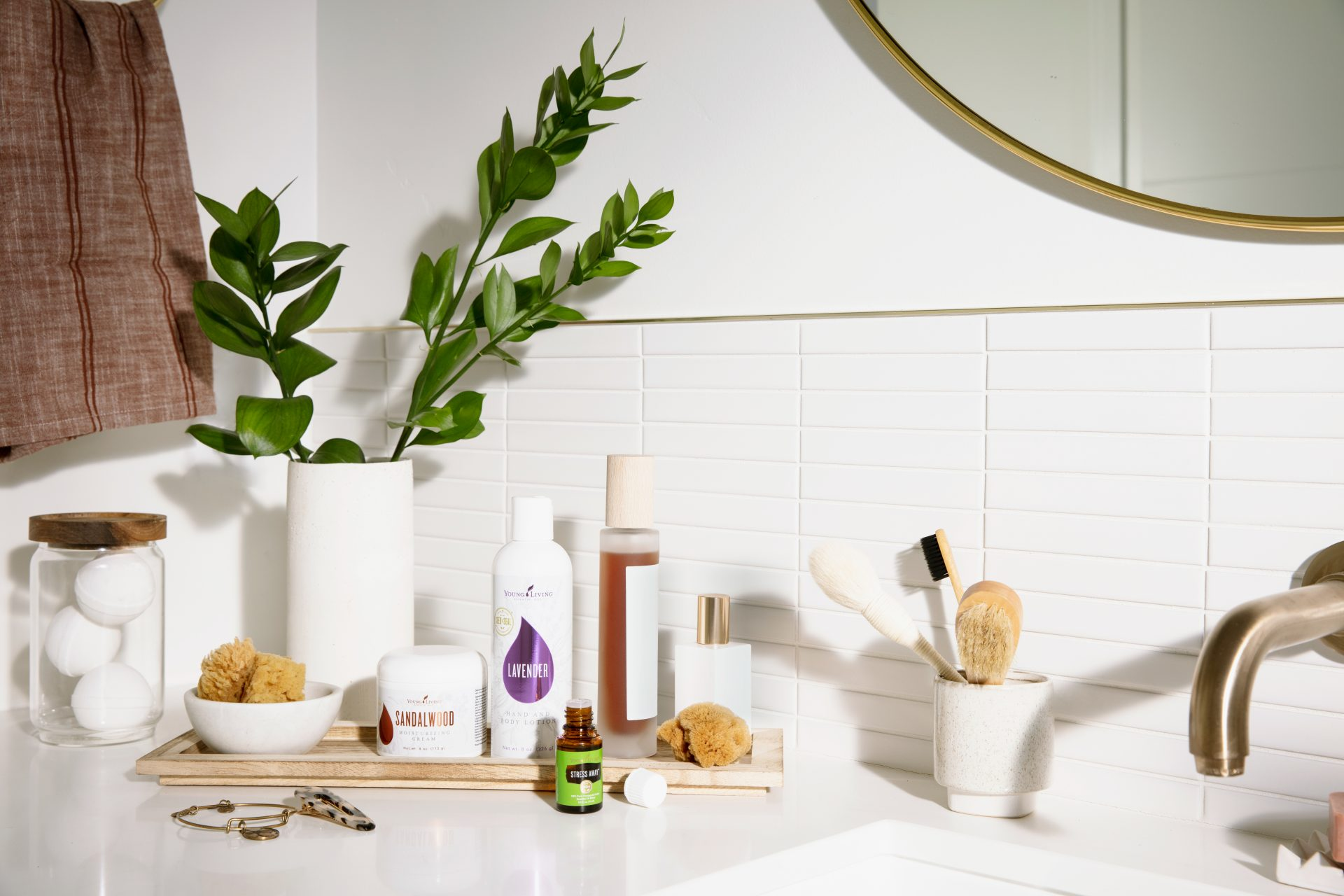 Young Living essential oil products on a bathroom vanity