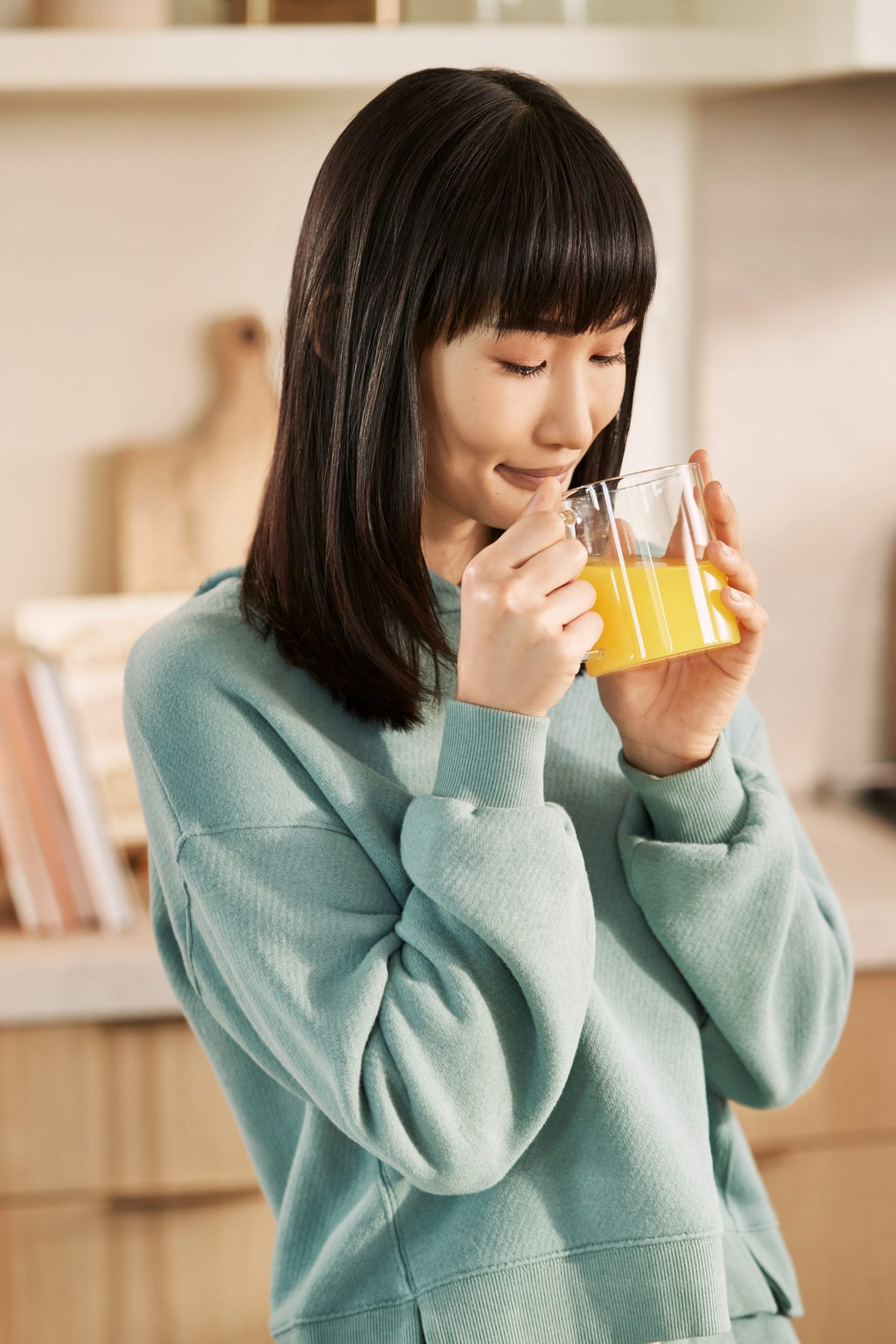 Woman drinking Golden Turmeric--Young Living Lavender Life Blog