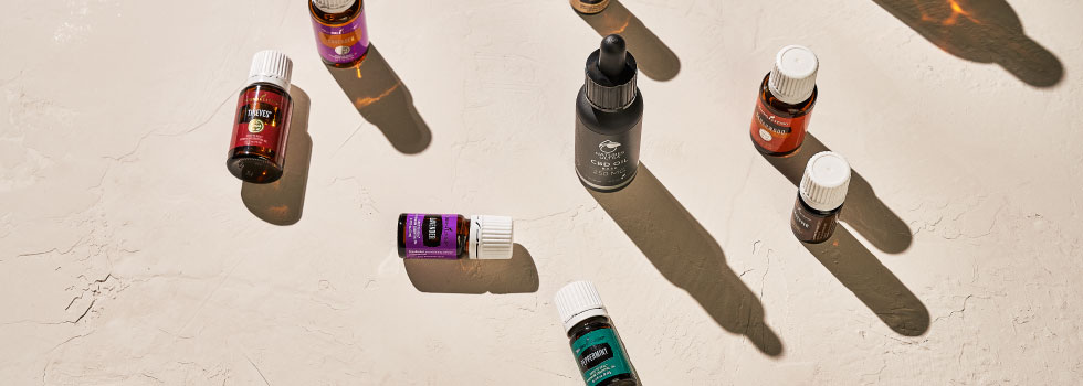 CBD Oil Base surrounded by essential oils - Young Living Essential Oils