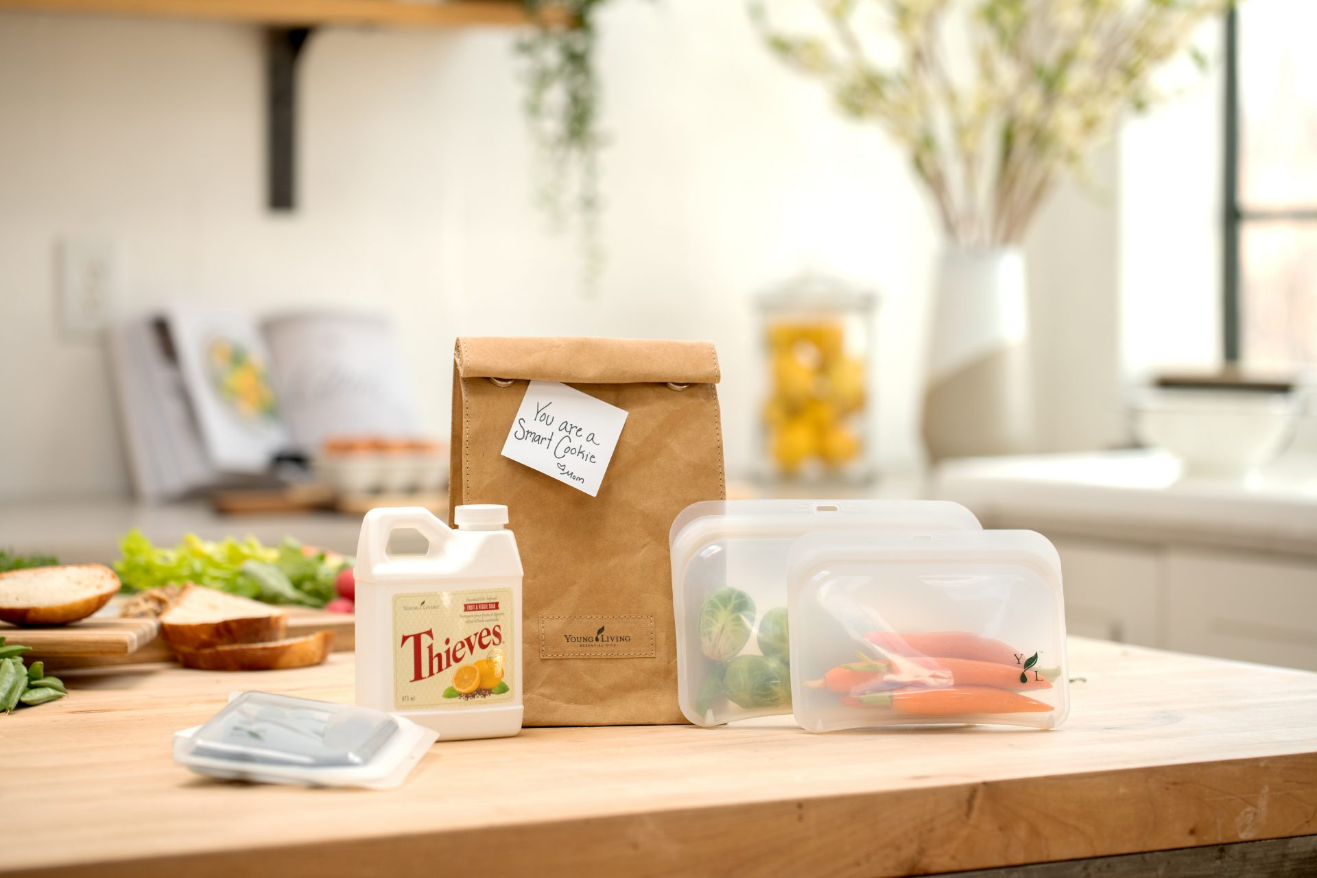 Packed school lunch sitting next to Thieves Fruit & Veggie Soak - Young Living Essential Oils