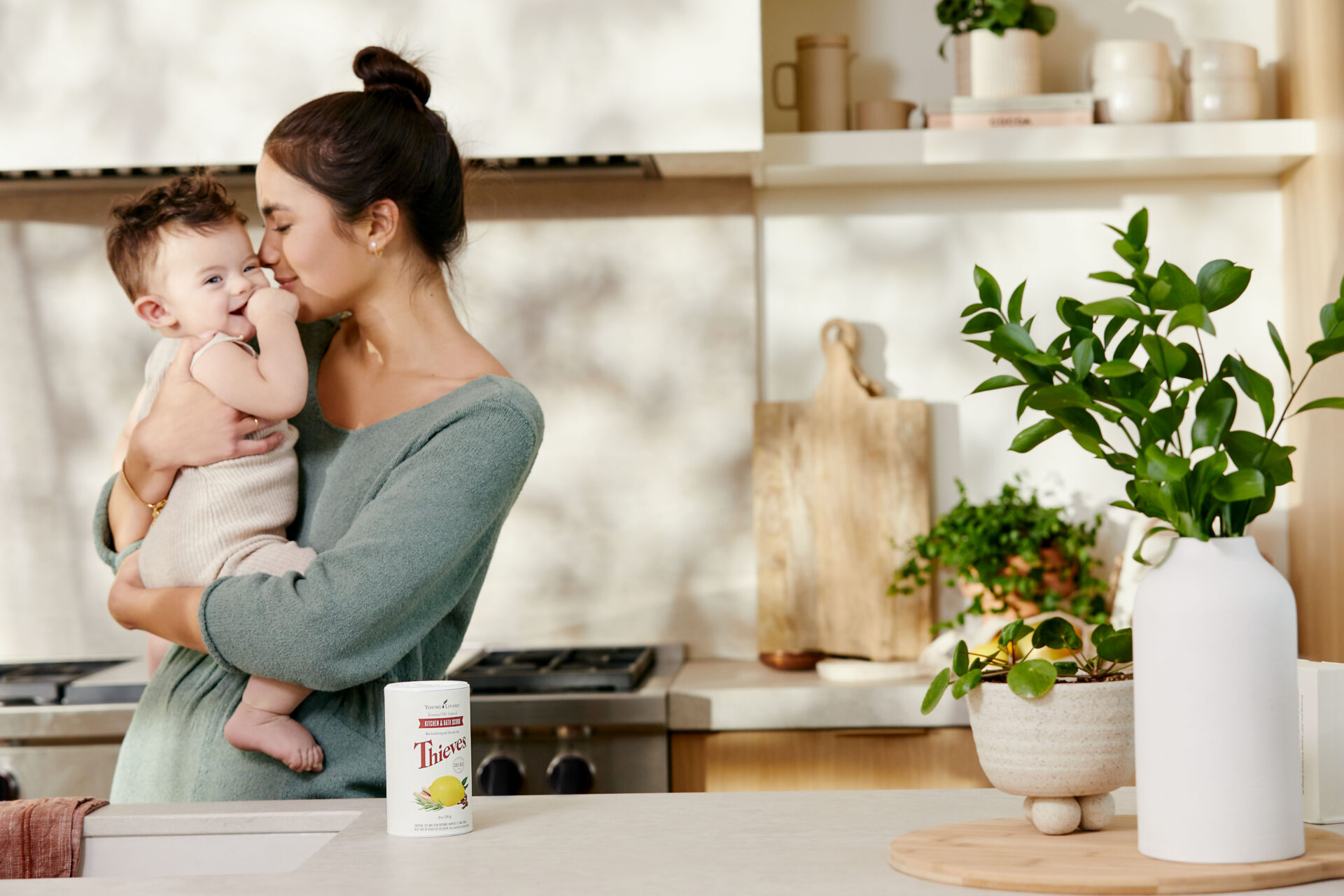 Mom & baby in kitchen with Thieves Kitchen & Bath Scrub on display - Young Living Lavender Life Blog