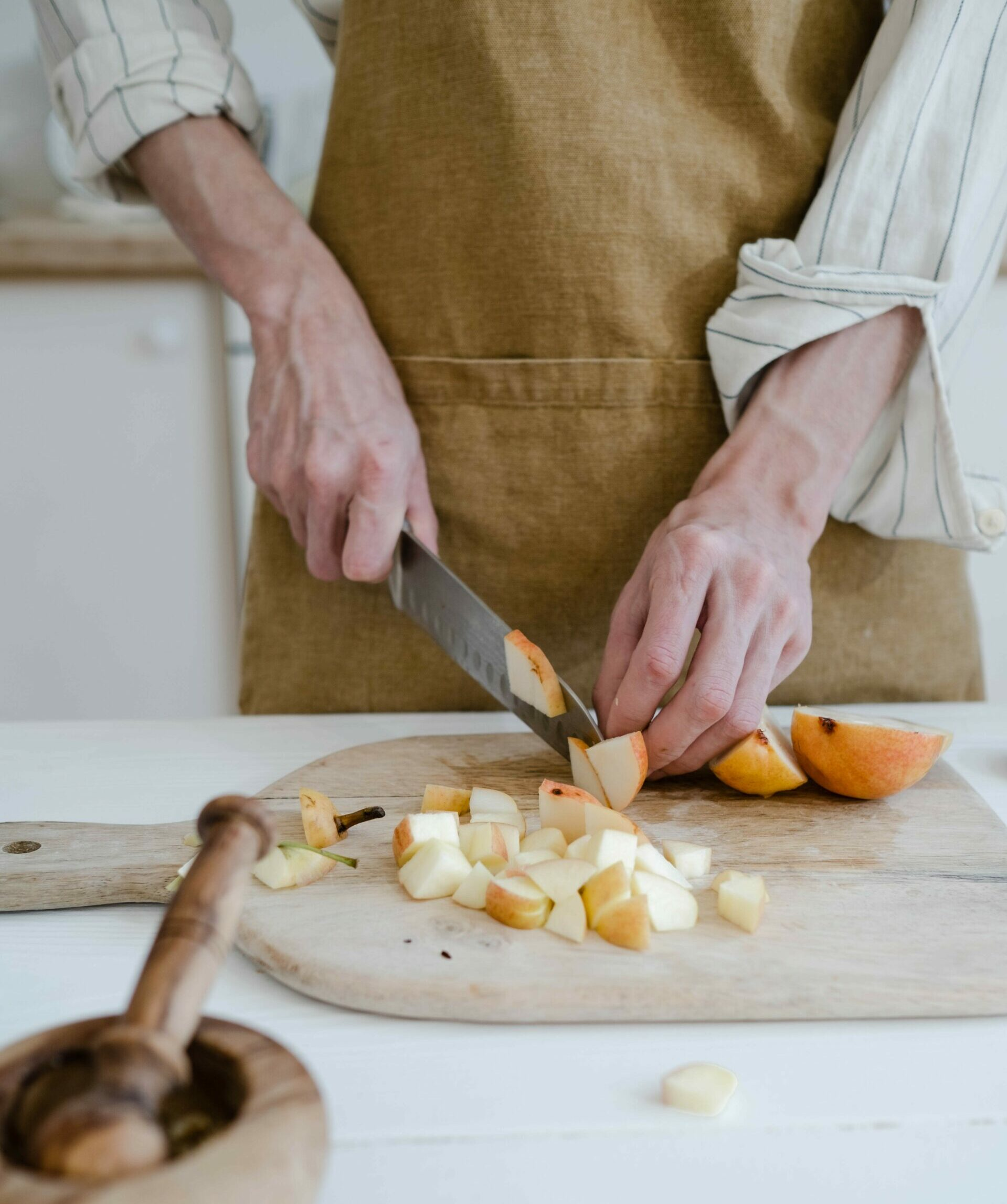 Person cutting apples into slices - Young Living Lavender Life Blog